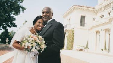 Portrait of Senior Newlyweds Standing in a Garden