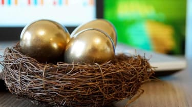 A nest with three gold eggs in it.