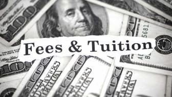 "The words ""fees & tuition"" atop cash"