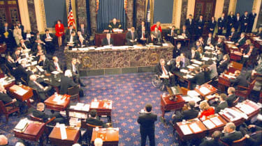 During an impeachment trial prompted by the Lewinsky sex scandal, presidered over by Chief Justice William Rehnquist (1924 - 2005) (center rear), the United States Senate votes on articles of