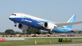 """""""Oshkosh, WI, USA - July 29, 2011:Brand new Boeing 787 Dreamliner in factory paint scheme taking off during EAA Airventure 2011."""""""