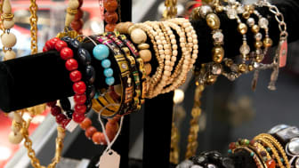 Close up of costume jewelry on a display rack