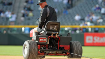 DENVER, CO - APRIL 16:Head groundskeeper Mark Razum of the Colorado Rockies drags the infield with a tractor prior to hosting the Chicago Cubs at Coors Field on April 16, 2011 in Denver, Colo