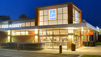 An exterior of an Aldi supermarket at night