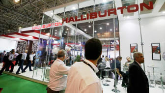 RIO DE JANEIRO, BRAZIL - SEPTEMBER 16:Visitors gather at the Halliburton booth at the Rio Oil & Gas Expo and Conference on September 16, 2014 in Rio de Janeiro, Brazil. The annual event is th