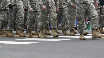 picture from waist down of soldiers marching