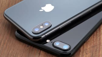 Koszalin, Poland – November 29, 2017: Space gray iPhone X and black iPhone 7. The iPhone X and iPhone 7 is smart phone with multi touch screen produced by Apple Computer, Inc.