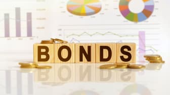 The word bonds written in blocks in front of charts and graphs.