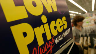"""A sign reads """"low prices"""""""