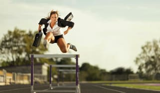 A speedy businesswoman flies over the business competition. Nothing will slow her down.