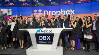 NEW YORK, NY - MARCH 23: Dropbox CEO Drew Houston and Dropbox co-founder Arash Ferdowsi (C) celebrate the launch of Dropbox's initial public offering as they ring the opening bell at Nasdaq M