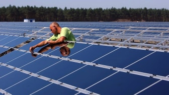 Man working on solar panels