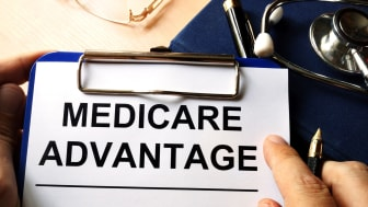 A clipboard with Medicare Advantage written on a piece of paper