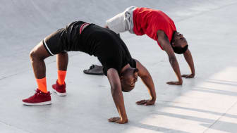 Two men doing backbends
