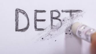 picture of the word debt being erased