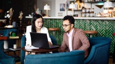 A financial planner meets a client in a restaurant.