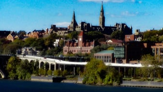 View of the Whitehurst Freeway with the Spires of Georgetown University on the hill in the background, seen from the forecourt of the Kennedy Center.