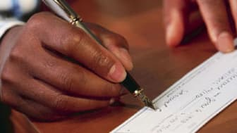 Signing a Check with a Fountain Pen