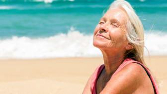 A senior woman suns on a Florida beach