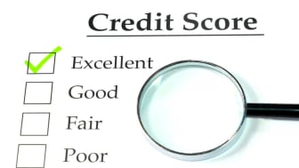 picture of credit score sheet with magnifying glass