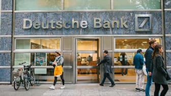 Berlin, October 2, 2017: Unknown man walks into the beautiful glass office of Deutsche Bank
