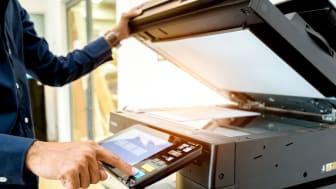Bussiness man Hand press button on panel of printer, printer scanner laser office copy machine supplies start concept.