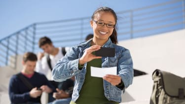 photo of a college student depositing a check with her phone
