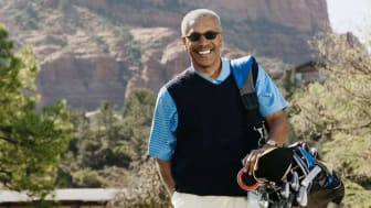 Senior man playing golf poses for a photo in Arizona