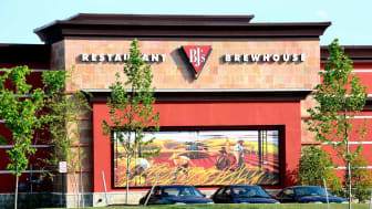 Gainesville, Virginia, USA - May 24, 2015: A BJ's Restaurant and Brewhouse is seen with its bright, colorful mural. BJ's Restaurant and Brewhouse has 159 casual dining locations throughout th