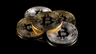 Physical version of Bitcoin coin aka virtual money. Conceptual composition for worldwide cryptocurrency and digital payment system called the first decentralized digital currency