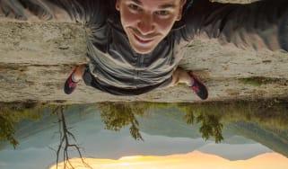 A man takes a crazy upside down selfie.