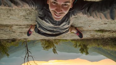 A man takes a crazy upside down selfie.