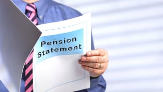 """A man reads a document titled """"Pension Statement."""""""