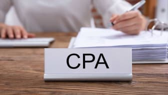 picture of CPA sign on accountant's desk