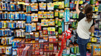 Teenager shopping for school supplies in a store