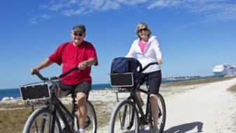 Senior Couple on bike ride while enjoying a cruise vacation