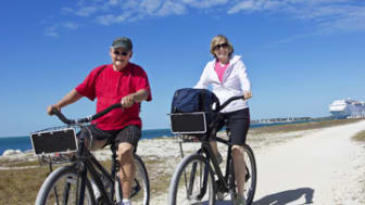 Senior Couple on bike ride while enjoying a cruise vacation
