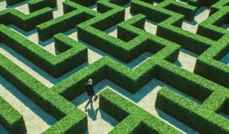 Man walking through a complicated maze