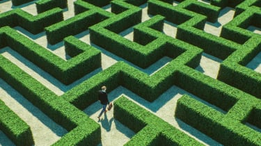 Man walking through a complicated maze