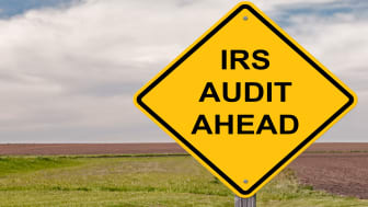 """picture of yellow road sign saying """"IRS Audit Ahead"""""""