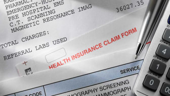 picture of medical bills and a health insurance claim form