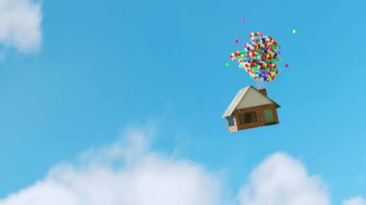 house floating away with balloons