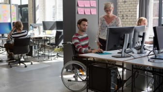 picture of man in wheelchair at work