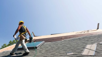 A roofer working on a residential roof