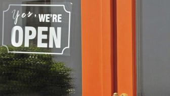 """A sign on a store door reads """"open"""""""