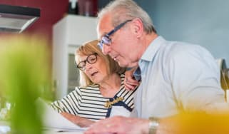 picture of elderly couple working on tax return