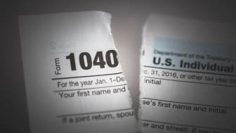 picture of a torn 1040 tax form