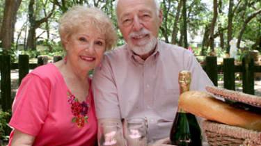 A senior couple enjoying a picnic in the park.