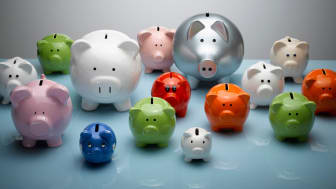 A selection of many piggy banks in different sizes, shapes and colors.