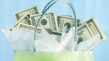 A gift bag with money peeking out